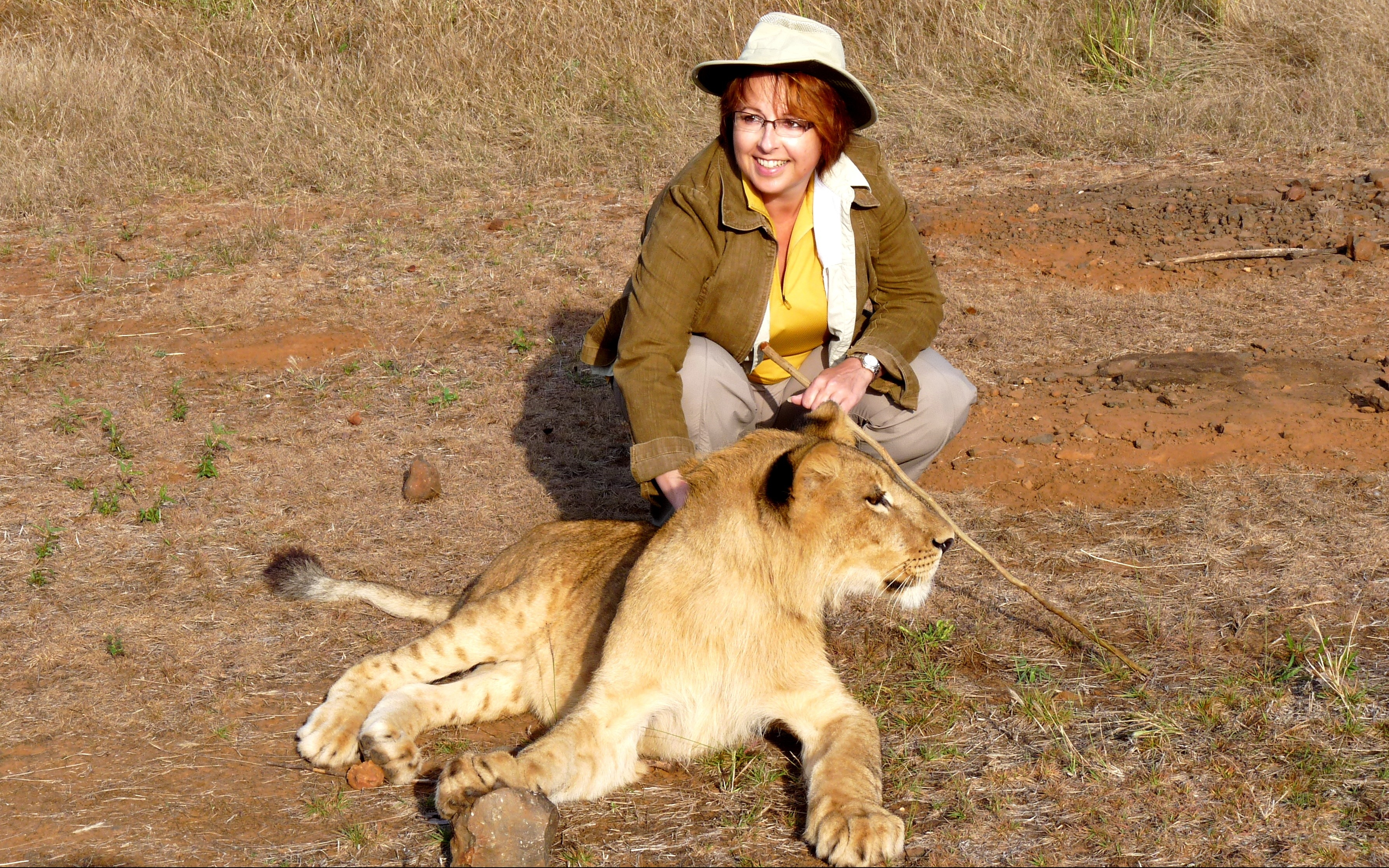 Erica with one of her lion buddies in Zimbabwe