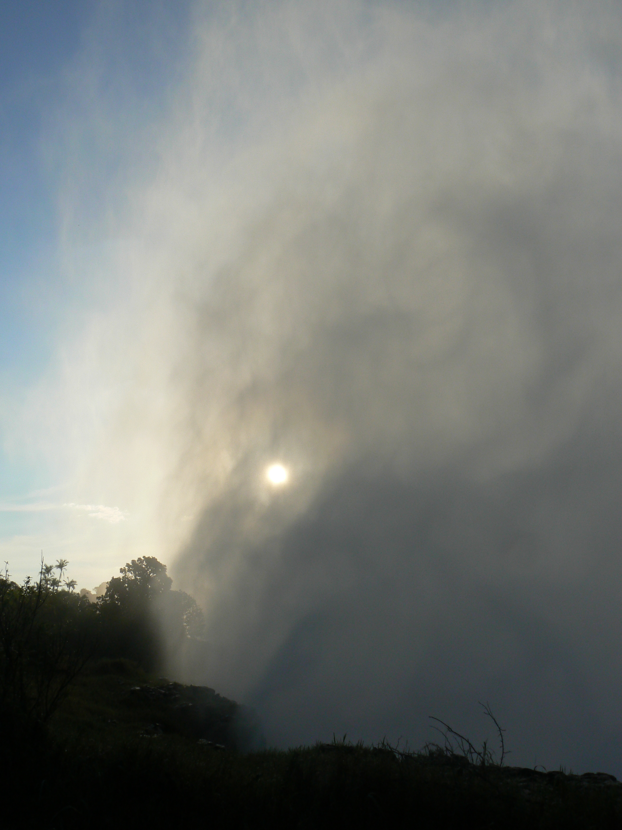 Spray from Victoria Falls billows over 1,000 ft into the air - photo by E. Jurus