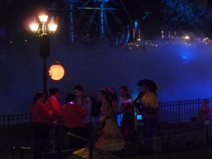 Adults lined up at the trick-or-treat station along the lagoon - photo by E Jurus