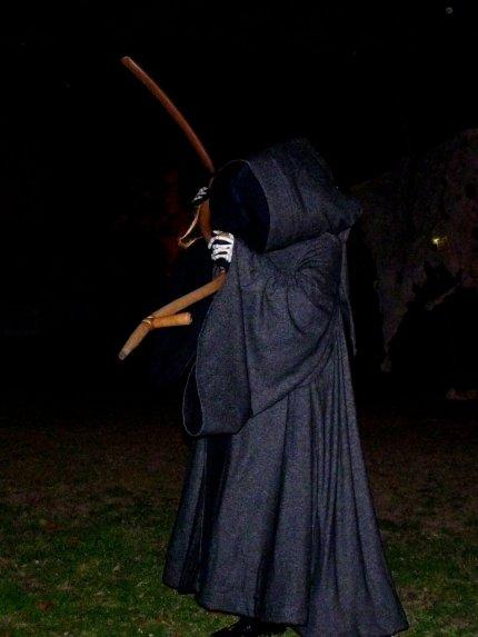 An eerie Grim Reaper stalks a field  - photo by E Jurus