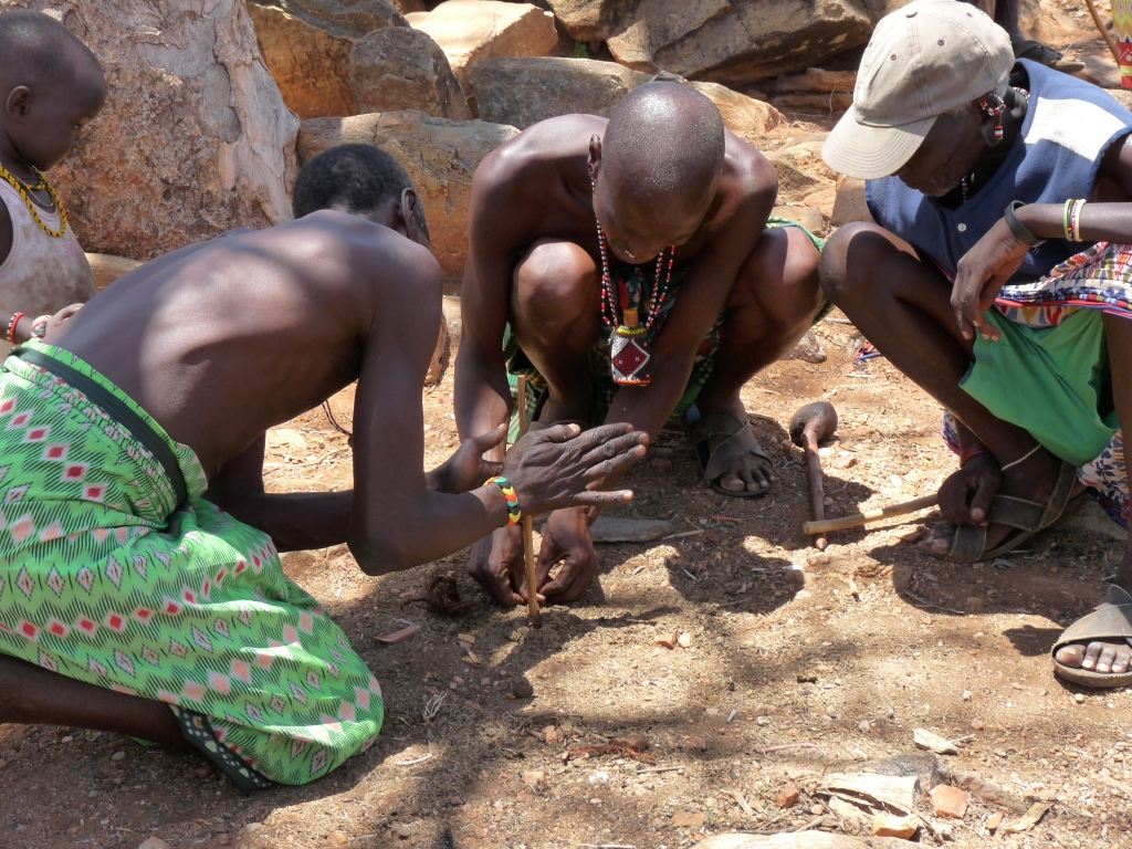 Samburu tribesmen demonstrating how to make fire the traditional way - photo by E Jurus