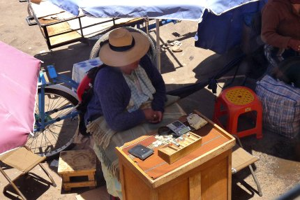 One of the sharp-eyed moneychangers at the border crossing - photo by E. Jurus