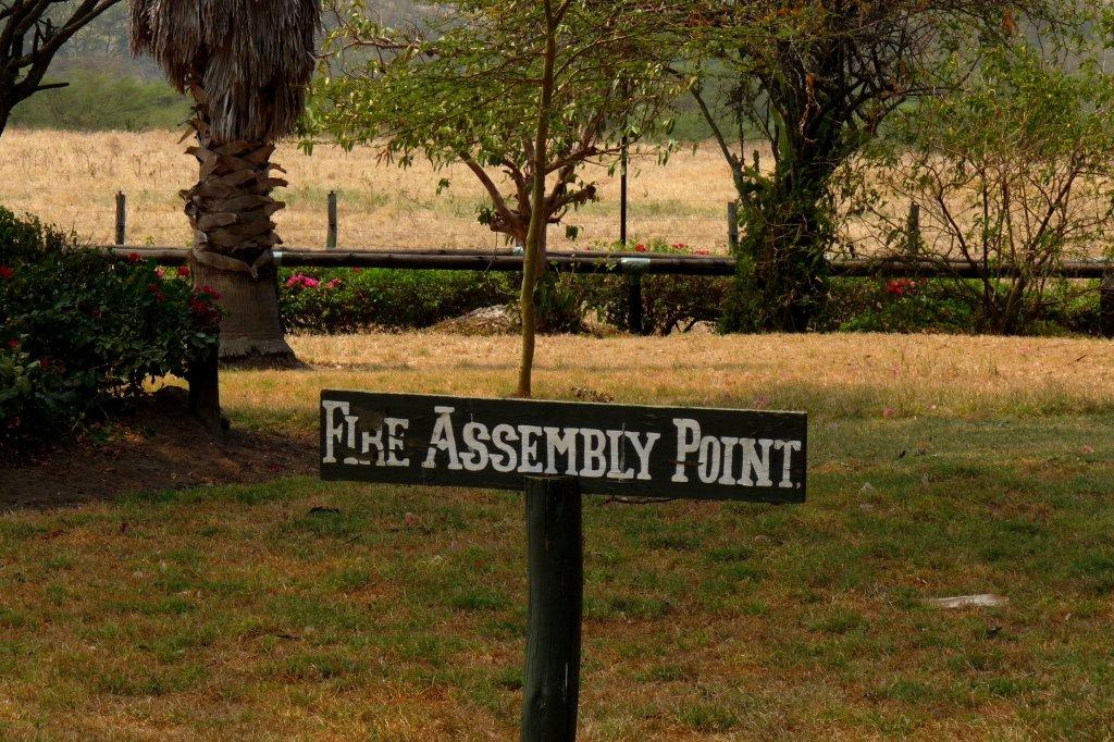 Sign on the lawn at Lake Nakuru Lodge, Kenya - photo by E. Jurus