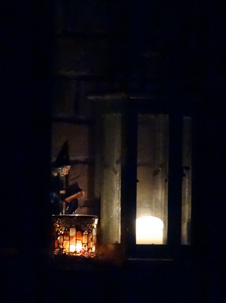 lit candles on a fireplace mantle